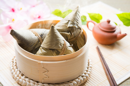 Asian Chinese rice dumplings or zongzi with tea Stock Photo