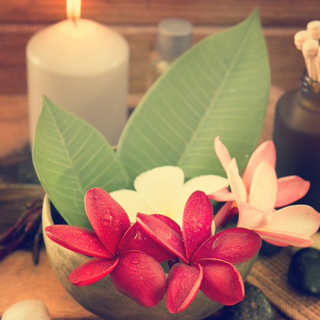 Tropical spa with Frangipani flowers in retro style. Low lighting, suitable for spa related theme. photo