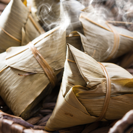 Asian Chinese rice dumplings on basket, fresh with hot steamed smoke photo