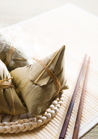 Chinese rice dumplings on bamboo place mat