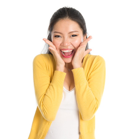 Young Asian girl surprises and shouts out, face expression, isolated on white background. Stock Photo