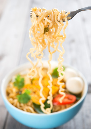 cooked instant noodle: Hot and spicy instant noodles soup, in curry flavour.  Stock Photo