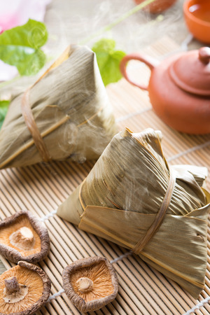 Traditional steamed sticky glutinous rice dumplings. Hot rice dumpling or zongzi. Chinese festive food. Asian cuisine. Stock Photo