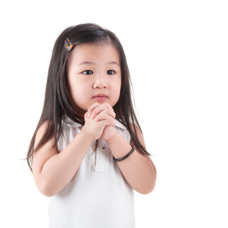 clasped: Little Asian girl making a wish, isolated on white  Stock Photo