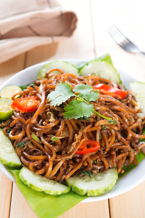 chinese noodle: Asian style spicy fried noodles, ready to serve on dining table.
