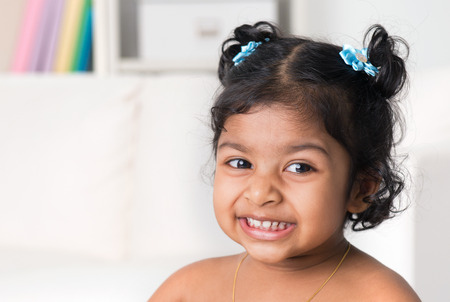 Portrait of little Indian baby girl smiling. Asian child living lifestyle at home. photo