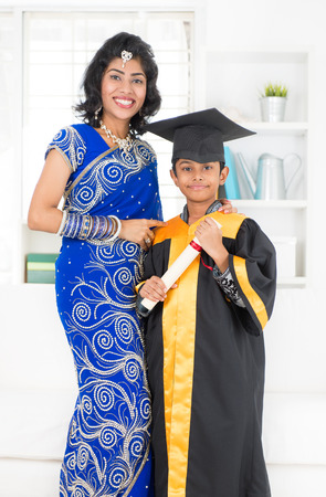 Kindergarten graduation. Asian Indian family, mother and son on kinder graduate day. photo
