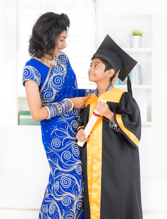 Kindergarten graduation. Asian family, Indian mother and son on kinder graduate day. photo