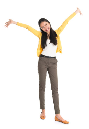 Portrait of an Asian girl open hands wide and smiling happy, full body standing isolated on white . photo
