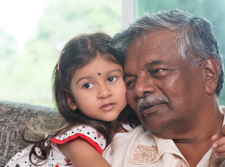 Portrait Indian family at home. Grandparent and grandchild close up face. Asian people living lifestyle. Grandfather and granddaughter. Stock Photo