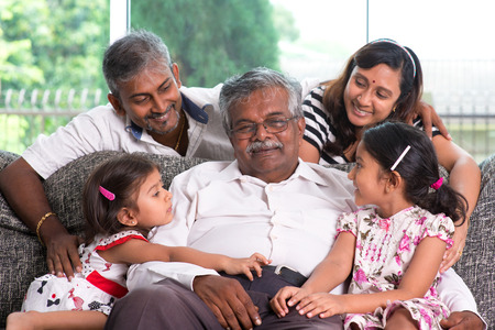 grandparents: Portrait of multi generations Indian family at home. Asian people living lifestyle.