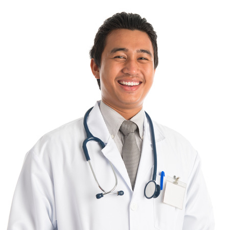 Portrait of handsome southeast Asian male medical doctor smiling, standing isolated on white . Young man model. photo