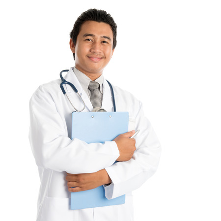 Portrait of southeast Asian male medical doctor holding file folder, standing isolated on white . Young man model. photo