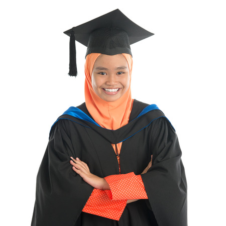 Portrait of smiling Asian female muslim student in graduate , isolated on white background.