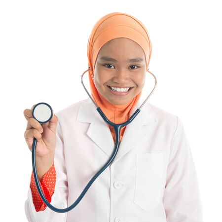 Young Muslim female doctor portrait, holding stethoscope standing isolated on white background. photo