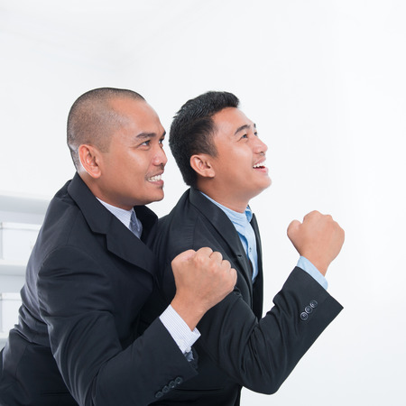 Southeast Asian businessmen celebrating success in office. Stock Photo
