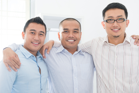 malaysian people: Southeast Asian business team in office.