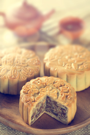 Retro vintage style Chinese mid autumn festival foods.  photo