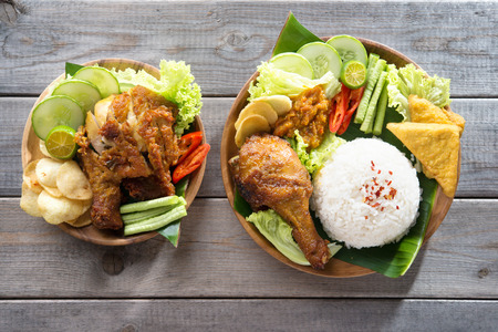 indonesian: Famous traditional Indonesian food. Delicious nasi ayam penyet with sambal belacan. Fried chicken rice. Stock Photo