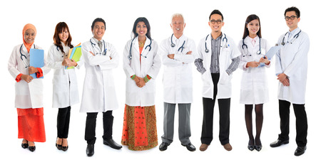 smiling female doctor: Multiracial diversity Asian doctors, medical team standing isolated on white background.