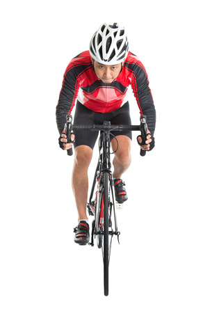 Asian male biker riding road bike, front view isolated on white background. photo