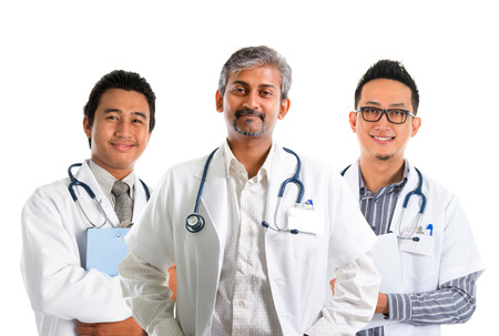 Multiracial doctors  diverse medical team standing isolated on white background photo