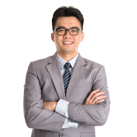 Portrait of Asian business man arms folded smiling, standing isolated on white background. photo