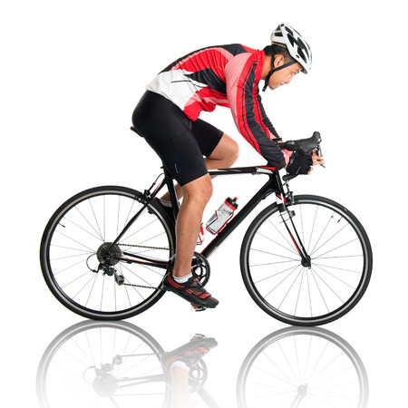 cycle ride: Asian male cyclist riding road bicycle, side view isolated on white background.