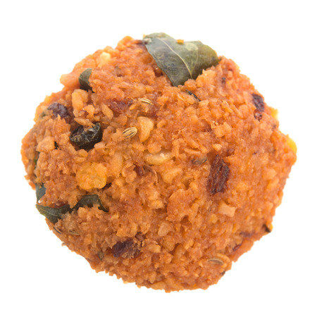 urad dal: Deep fired vadai snack from South India, very common street food in the Indian Subcontinent and Sri Lanka, shoot isolated on white background.