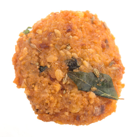 urad dal: Crispy deep fired vadai snack, very common street food in the Indian Subcontinent and Sri Lanka, shoot isolated on white background.