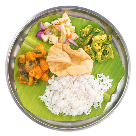 Overhead view of full length Indian vegetarian mixed rice isolated on white background. photo