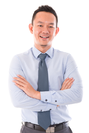 Asian business man smiling, standing isolated over white background. photo