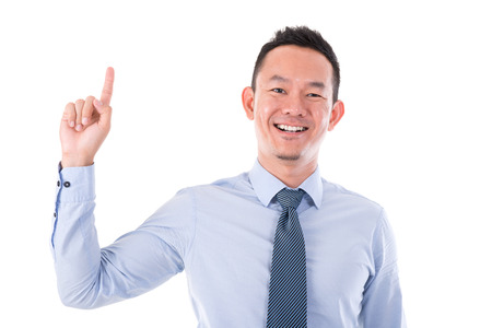 Asian business man smiling and finger pointing up, isolated over white background. photo