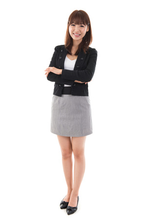 Full length Asian businesswoman standing isolated on white background. photo