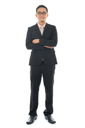 pan asian: Full length pan Asian businessman crossed arms standing isolated on white background.