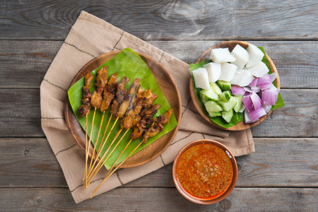 peanut sauce: Hot and spicy Asian dish. Delicious chicken sate or satay, skewered and grilled meat, served with peanut sauce. Fresh cooked with steamed and smoke.