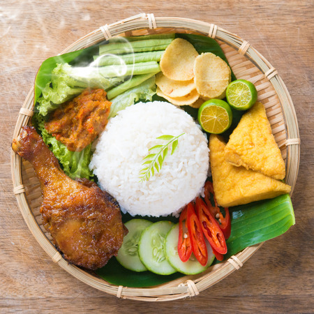 indonesian food: Famous traditional Indonesian food. Delicious nasi ayam penyet with sambal belacan. Fresh hot with steam smoke.
