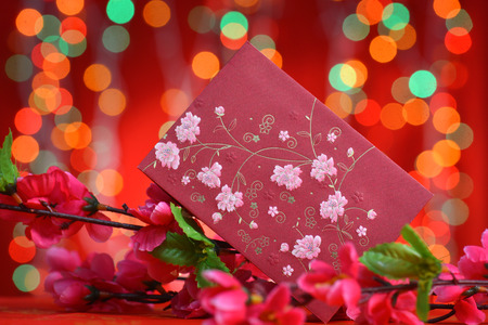 ang: Chinese new year festival decorations, ang pow or red packet and plum flower. Stock Photo
