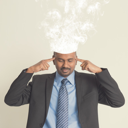 burnout: Businessman head burnout, smoke coming out from head.