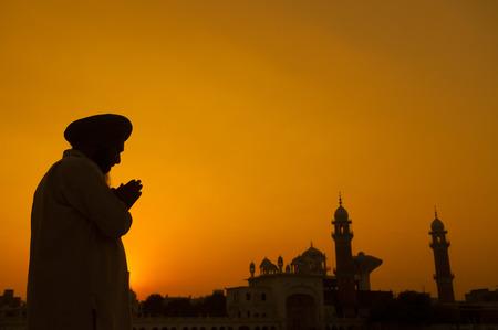 sikh: Silhouette of Sikh prayer at temple, Amritsar, India