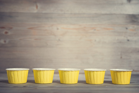 Paper muffin cups isolated on white background photo