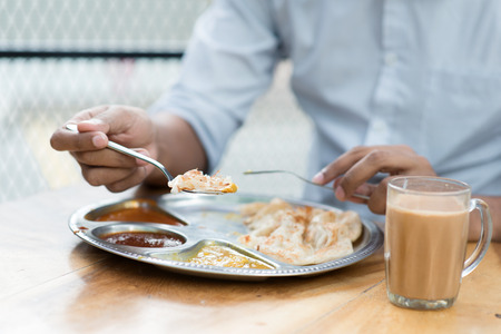 indian meal: Man having Indian meal at cafeteria.