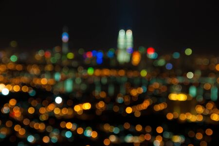purposely: Blurred lights of Kuala Lumpur skyline, purposely defocused.