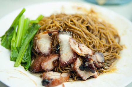 mee: Popular Malaysian Chinese street food, wantan mee, kind of noodles serve with dumpling. Stock Photo