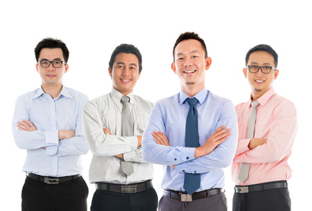 Portrait of group Southeast Asian businessmen standing isolated on white background Imagens