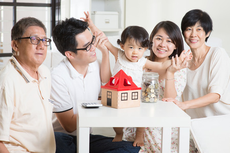 money jar: Family money saving or future financial planning concept. Asian multi generations lifestyle at home.