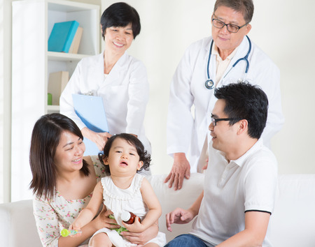 healthcare: Toddler cries after consult family doctor. Pediatrician and patient healthcare concept. Stock Photo