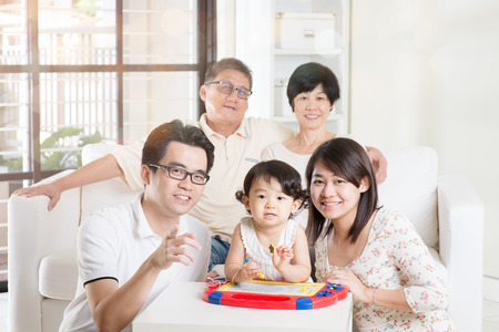 family indoors: Portrait Of Asian Multi Generation Family