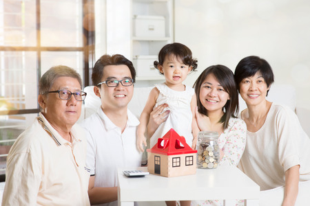 malaysian people: Family future investment or financial planning concept. Asian multi generations lifestyle at home.