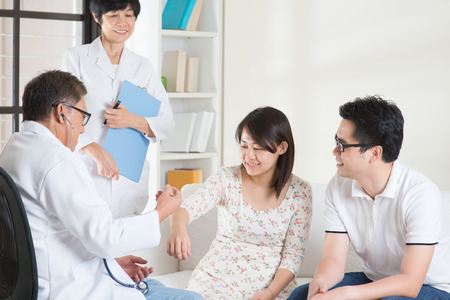 checkup: Asian couple consult doctor. Woman health concept.